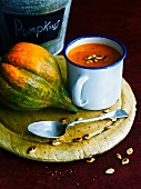 Squash soup with toasted pumpkin seeds