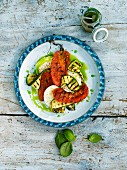 Salad with grilled tomatoes, courgette and basil oil