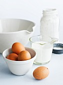 Assorted baking ingredients: eggs, milk, a mixing bowl