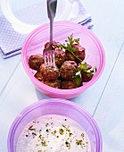 Meatballs with yoghurt sauce in Tupperware containers