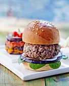 Barbecued lamb burger with aubergine and lemongrass