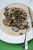 Chopped venison in a creamy sauce with mushrooms