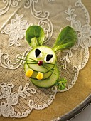 A cucumber hare with lamb's lettuce ears