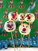 Cake pops with clown's faces for a children's party