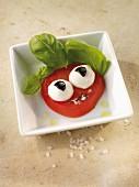 Caprese with mozzarella balls as eyes