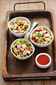 Noodle salad with surimi, cucumber, peas, coriander and chilli sauce (Asia)