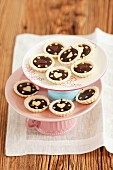 Mini tartlets with chocolate, on a tiered cake stand