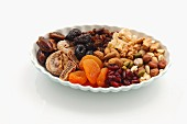 Assorted dried fruit and nuts on a plate