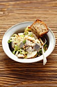 Herring salad with leek, apple and walnuts