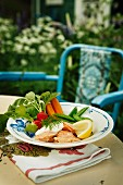 Salmon with sour cream, radishes, carrots and peas