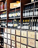 A selection of wine bottles in a wine shop