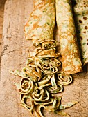 Rolled herb pancakes, partly sliced