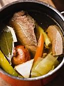 Beef broth in a saucepan