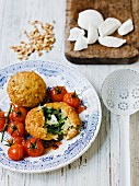 Spinach dumplings with roasted cherry tomatoes and mozzarella