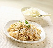 Gluten Free Rotini Pasta with Shaved Cheese on a White Dish