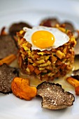 Chanterelle tatare with quail's egg and black truffles