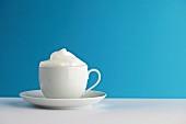 Milchschaum in einer Tasse