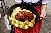 Roast pork in the tin with pointed cabbage and dumplings (Austria)