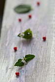 Pink peppercorns on a wooden board