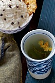 Cashew nut dip with pineapple crisps and herbal tea