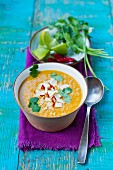 Squash soup with coconut, chilli rings and coriander (Asia)