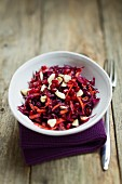 Red cabbage salad with pomegranate and Brazil nuts