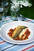 Sea bass on a bed of tomato salsa
