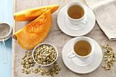Pumpkin seed tea, pumpkin seeds and wedges of pumpkin