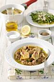 Lamb stew with artichokes, garlic and parsley