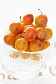 Mirabelle plums in a glass bowl