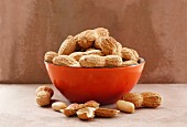 Peanuts in a red bowl