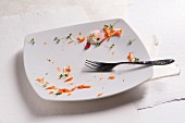 The remains of carrots and cress on a plate