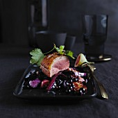 Duck breast with red cabbage and blackcurrants