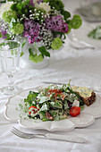 Salad on white plate with scalloped edge
