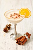 Baileys milk drink with cinnamon and a slice of orange (for Christmas)