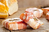 Young goat's cheese wrapped in bacon with herbes de Provence