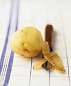 A half-peeled potato