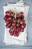 Red grapes on pieces of linen