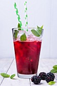 Blackberry spritzer with mint leaves
