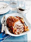 Crackling roast port, partly sliced