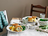 Salmon cakes with herbs and peas