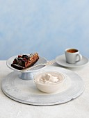 White chocolate creme, chocolate cake and a cup of coffee