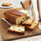 Fruit bread with raisins and butter