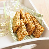 Sesame biscuits and drinks on a tray