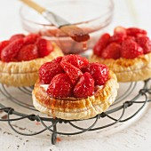 Strawberry tartlets on cooling rack