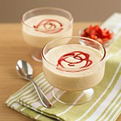 Zabaglione cream (Italian custard) with strawberry sauce