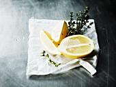 Lemon and fresh thyme on a cloth