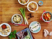Assorted Chinese dishes on a wooden table