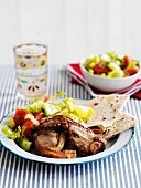Lamb cutlets with Greek salad and flat bread