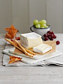 Soft cheese, grissini and grapes